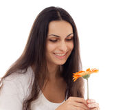 Young beautiful woman with orange flower  isolated Royalty Free Stock Photography