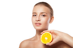 Young beautiful woman with orange over white Royalty Free Stock Images