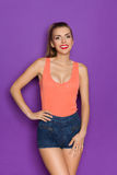 Young Beautiful Woman In Orange Tank Top Stock Photography