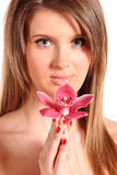 Young beautiful woman with orchid Stock Photography