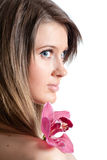 Young beautiful woman with orchid Stock Photo