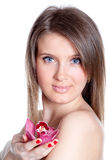 Young beautiful woman with orchid Royalty Free Stock Photos