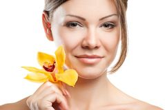 Young beautiful woman with orchid Royalty Free Stock Image