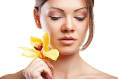 Young beautiful woman with orchid Stock Images