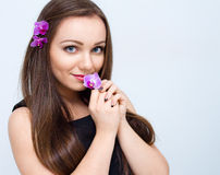 Young beautiful woman with orchid flower Royalty Free Stock Photo