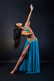 Young beautiful woman in oriental dance Stock Images