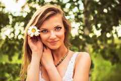 Young beautiful woman outdoor in a birchwood Stock Image