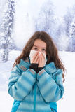 Young beautiful woman outdoor blowing nose in Stock Photo
