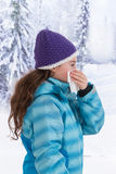 Young beautiful woman outdoor blowing nose in Stock Images