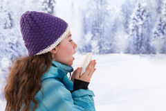 Young beautiful woman outdoor blowing nose in Royalty Free Stock Photos