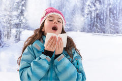 Young beautiful woman outdoor blowing nose in Stock Photos