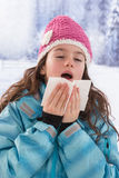 Young beautiful woman outdoor blowing nose in Stock Image