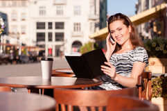 Young beautiful woman in an outdoor cafe Stock Photo