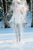Young beautiful woman outdoor in the snow Stock Photography