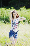 Young beautiful woman outdoors. Portrait of the young beautiful woman outdoors Royalty Free Stock Photography