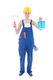 Young beautiful woman painter in workwear with paintbrush and bu Royalty Free Stock Image