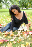 Young beautiful woman in the park Stock Photography