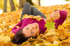 Young beautiful woman in the park royalty free stock images