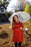 Young beautiful woman in the park in a fashion shot, looking away and smiling - caucasian woman, autumn, fall, park Stock Photography