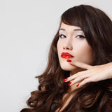 Young beautiful woman with pefect long hair and vivid red lipsti Royalty Free Stock Photography