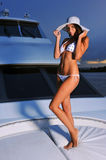 Young beautiful woman with perfect slim body posing on yacht Stock Photo