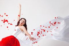 Young beautiful woman with petals of roses Royalty Free Stock Photography