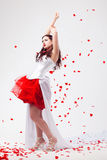 Young beautiful woman with petals of roses Stock Photo