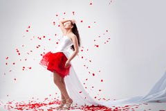 Young beautiful woman with petals of roses Stock Photography