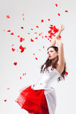 Young beautiful woman with petals of roses Stock Photos