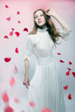 Young beautiful woman with petals of roses Royalty Free Stock Image