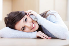 Young beautiful woman on phone at home Royalty Free Stock Photos