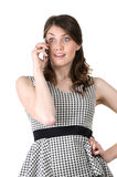 Young beautiful woman on the phone knew the shocking news Stock Photography
