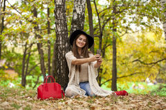 Young beautiful woman photographing themselves on a cell phone w Stock Image