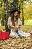 Young beautiful woman photographing themselves on a cell phone w Royalty Free Stock Photography