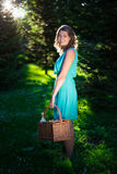 Young beautiful woman with picnic basket and bottle of wine in e Stock Photos