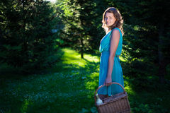 Young beautiful woman with picnic basket and bottle of wine in e Stock Photo