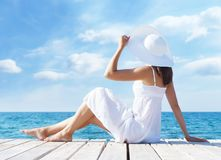 Young and beautiful woman on a pier at summer Royalty Free Stock Photo