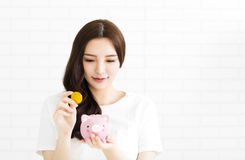 Young beautiful woman with  piggybank Royalty Free Stock Images