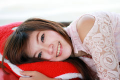 Young beautiful woman on pillow Royalty Free Stock Photos
