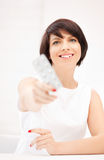 Young beautiful woman with pills Stock Photos