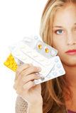 Young beautiful woman with pills. Stock Images