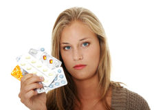 Young beautiful woman with pills. Royalty Free Stock Photos