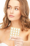 Young beautiful woman with pills Royalty Free Stock Photos