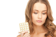 Young beautiful woman with pills Royalty Free Stock Photography