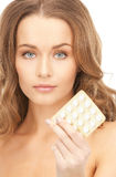 Young beautiful woman with pills Royalty Free Stock Photo