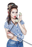 Young beautiful woman in pin-up style with retro telephone isola Royalty Free Stock Images