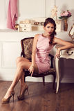 Young beautiful woman in pink dress. Fashion model shooting. Royalty Free Stock Image