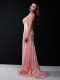 Young beautiful woman in a pink dress Stock Photo