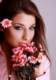 Young beautiful woman with pink flower.  Stock Photos