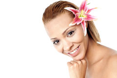 Young beautiful woman with pink flower Royalty Free Stock Images